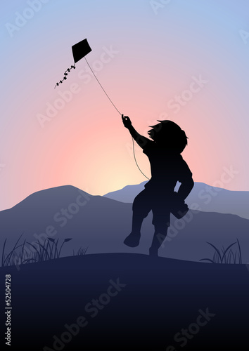 A boy playing a kite in the beautiful morning scene