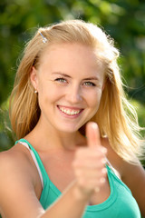 beautiful woman showing thumbs up gesture