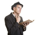 Man reading a book and thinking