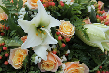Roses and lillies in a bridal arrangement