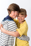 Two Young boy standing together hugging