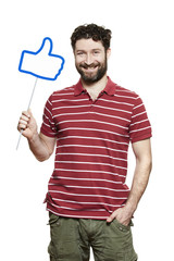 Man holding a social media sign smiling
