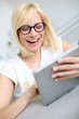 Blond girl websurfing with tablet