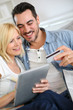 Couple shopping on internet with credit card