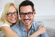 Middle-aged couple wearing eyeglasses