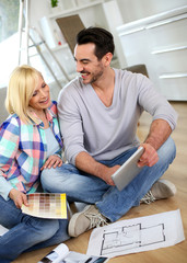 Couple looking at new home construction plan