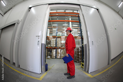 worker standing in the doorway of storehouse