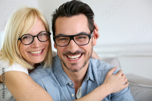 Middle-aged couple wearing eyeglasses