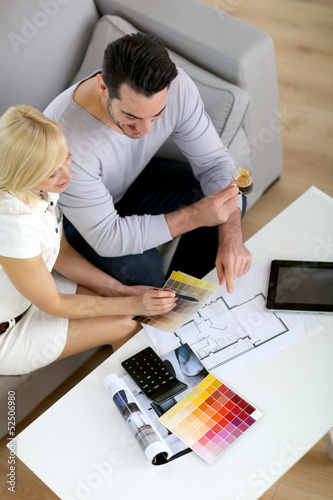 Couple working on home remodellng