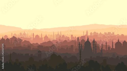 Naklejka Ilustracja arab poziomy wielkiego miasta o zachodzie słońca.