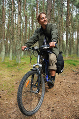 Young man on bicycle with backpack - bicycle travel