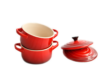 Two red cocottes  with covers on a white background