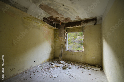 inside of  a Spooky abandoned room with a window