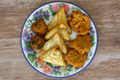 Selection of Indian vegetarian starters on vintage plate