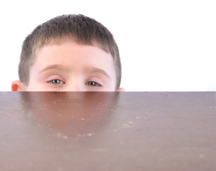 Child Hiding Behind Kitchen Table