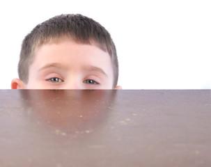 Child Hiding Behind Kitchen Table