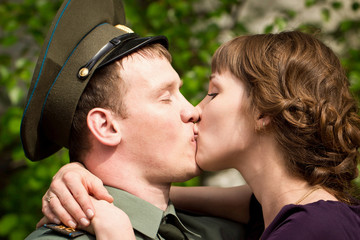 The girl kisses the military