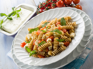 pasta with feta cheese fresh tomatoes and mint leaf