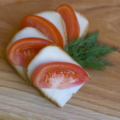 Snack of cheese and tomatoes, chopped slices