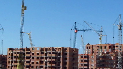 House construction with cranes. Time lapse