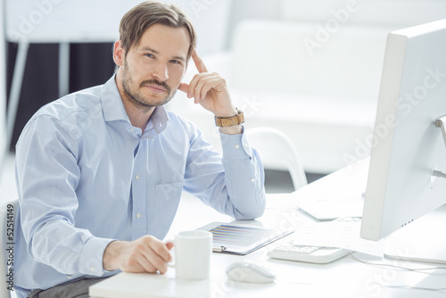 Handsome Businessman working at his desk