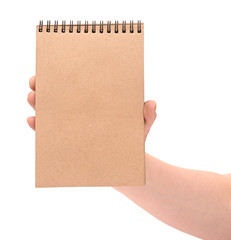a hand holding a recycled notebook, isolated on white background
