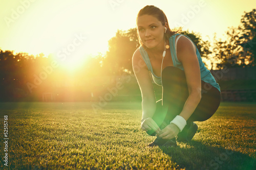 Young woman preparing to run