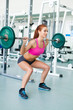 Gym fitness woman working out doing weight training