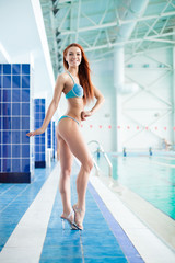 fitness model show sexy fitness body swimming pool