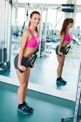 Attractive young fitness model exercising fitness sport club