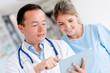 Doctor talking to a nurse