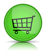 Green glossy web button with shopping cart sign.