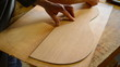 Luthier draws shape guitar in wood