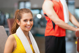 Fototapety Woman smiling in a fitness club