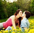 Young couple kissing outdoors.
