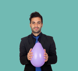 Young businessman with purple balloon