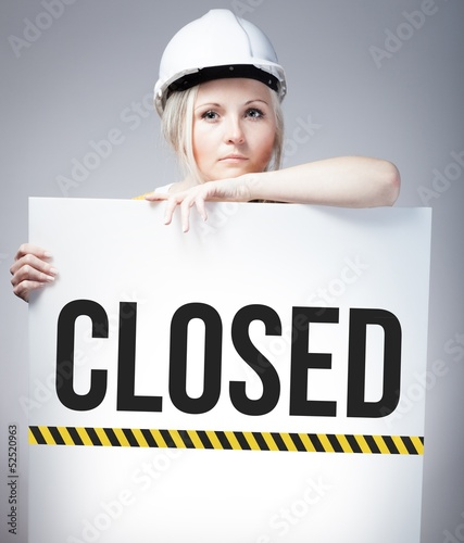 Closed sign on information poster, worker woman