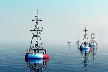 Sea buoys during day.