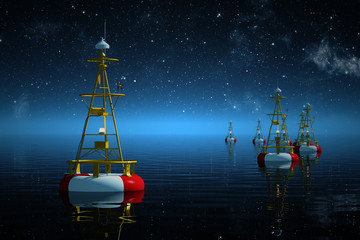 Sea buoys at night.