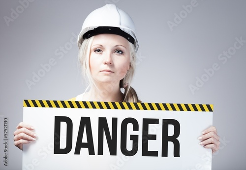Danger sign held by worker