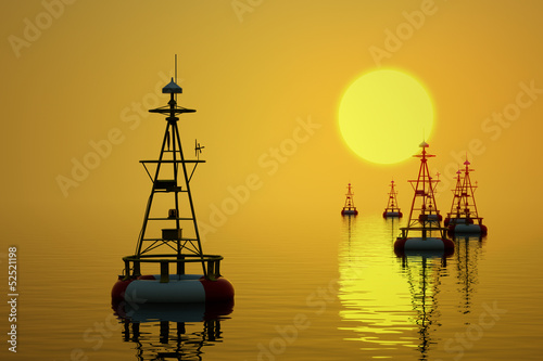 Sea buoys at sunset.