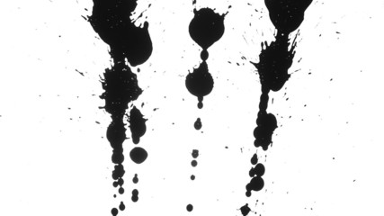 Ink blots are falling on the white paper