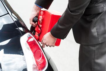 Man refueling his car