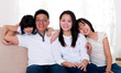 Asian family sitting on sofa