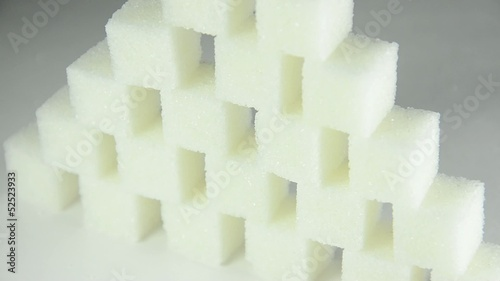 Pyramid of white sugar cubes (rotating)