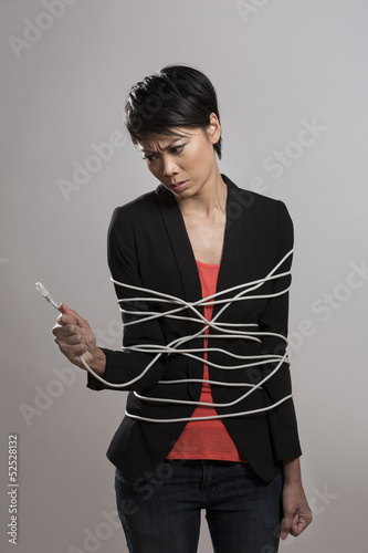 Chinese woman Wrapped up in computer network cable.