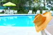 Wicker hat with swimming pool