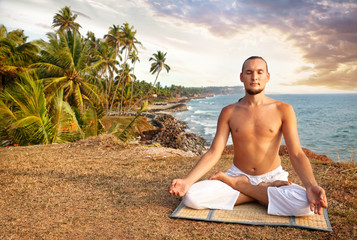Yoga meditation near the ocean