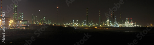 Big oil refinery at night