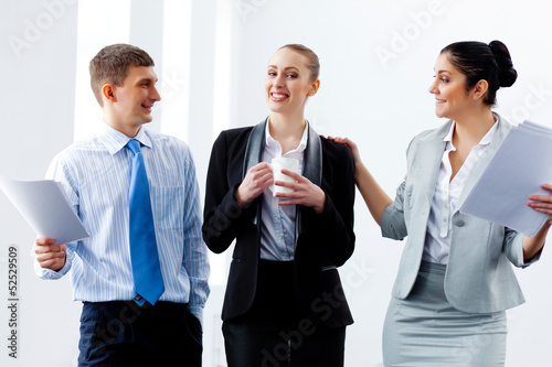 Three young business people laughing